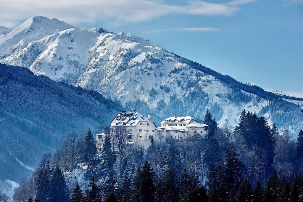 A castle in snowy mountains